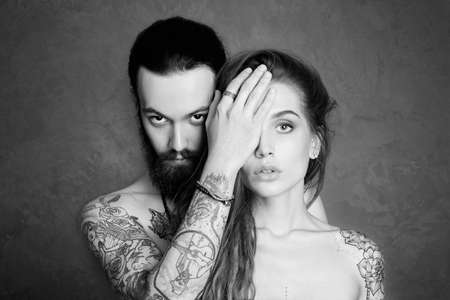 Photo pour sexy beautiful couple with tattoo.beauty woman and handsome man.lovely boy and girl - image libre de droit
