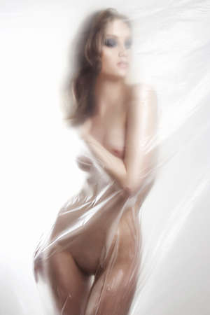 Photo for beautiful body nude woman. sexy girl behind a polyethylene film. Fine-art photo. figure of a naked woman behind a transparent curtain - Royalty Free Image