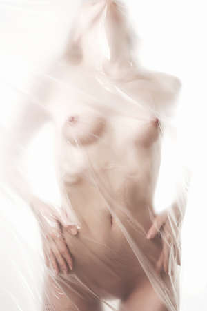 Photo for beautiful nude woman silhouette. girl in shower behind a polyethylene. figure of a naked woman behind a transparent curtain - Royalty Free Image