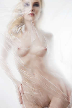 Photo for beautiful blond nude woman. sexy girl behind a polyethylene film. Fine-art photo. figure of a naked woman behind a transparent curtain - Royalty Free Image