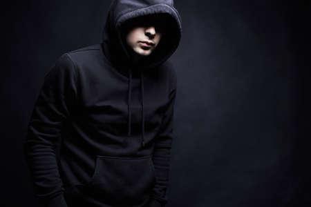 Foto de Man in Hood. Boy in a hooded sweatshirt. Fashion portrait - Imagen libre de derechos