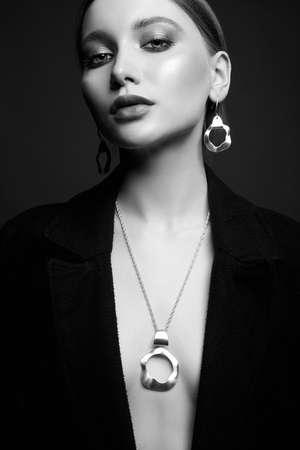 Foto de Beautiful sexy woman in jewelry. black and white stylish portrait of sexual girl - Imagen libre de derechos