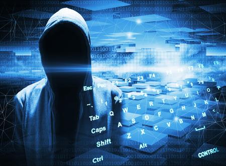 Foto de Hacker in a hood on dark blue digital background - Imagen libre de derechos