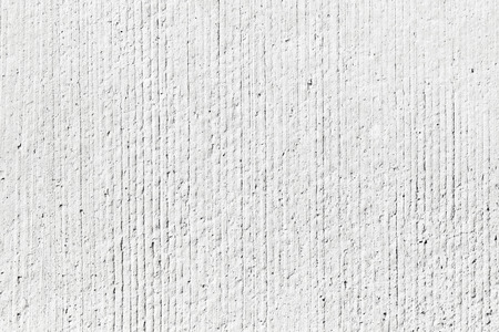 Photo pour Rough white concrete wall background texture with vertical relief lines - image libre de droit