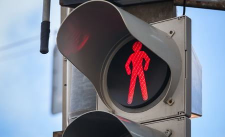 Foto de Modern pedestrian traffic lights with red stop signal - Imagen libre de derechos