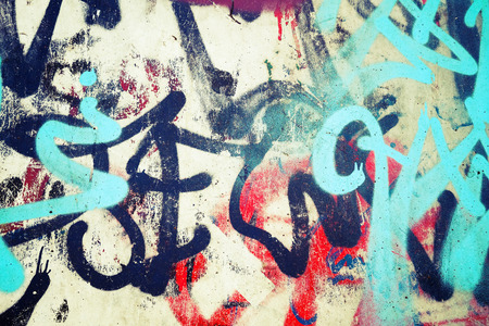 Foto de Abstract colorful graffiti patterns over old urban concrete wall, vintage tonal photo filter effect, retro style - Imagen libre de derechos