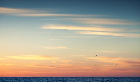 Foto de Colorful sunset sky over Atlantic ocean, natural background photo with warm tonal correction photo filter - Imagen libre de derechos