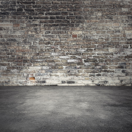 Foto de Empty abstract interior background with dark old brick wall and asphalt floor - Imagen libre de derechos