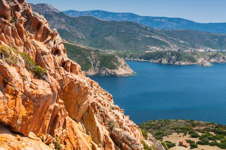 Foto de Coastal landscape of Corsica island with red rocks and blue sea water. Viewpoint of Capo Rosso, Piana region - Imagen libre de derechos