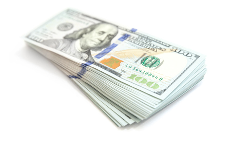 Photo pour United States currency, bundle of One Hundred Dollars isolated on white, close up photo with soft shadow and selective focus - image libre de droit