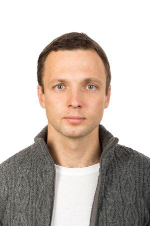 Photo pour Closeup studio face portrait of young European man isolated on white background - image libre de droit