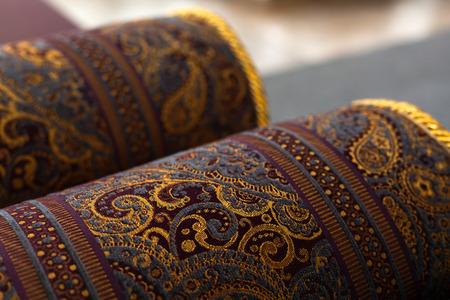 Foto de Rolled oriental carpets, close up photo with soft selective focus - Imagen libre de derechos