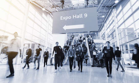 Foto de blurred people at a trade fair hall - Imagen libre de derechos