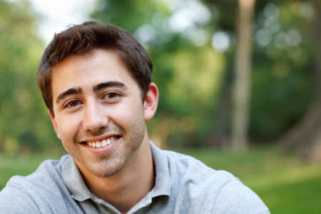 Portrait of a young man at the park