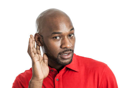 Foto de Portrait of a handsome excited black man in his late 20s cupping ear listening isolated on white - Imagen libre de derechos