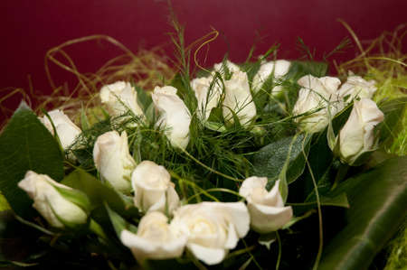 Beautiful bouquet of elegant pure white roses in soft light,with baby\'s breath. Wedding flowers.