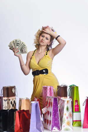 young woman with shopping and money