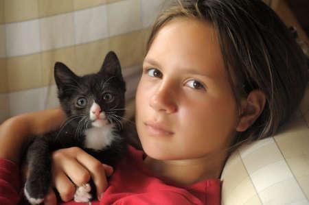 teen girl with a kitten