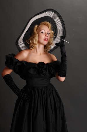 elegant woman in a hat smoking