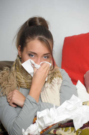 Young woman is ill in bed  She is feeling miserable