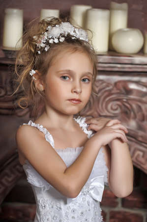 The little girl in a dress of the bride