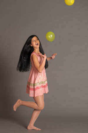 Girl With a studio with balloons