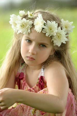 little girl in a wreath of white flowers
