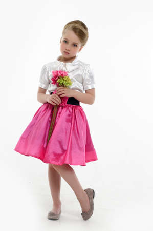 little girl with a retro hairstyle and flowers in their hands