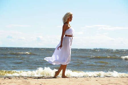 girl in a white dress on the coast