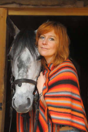 a woman with a horse