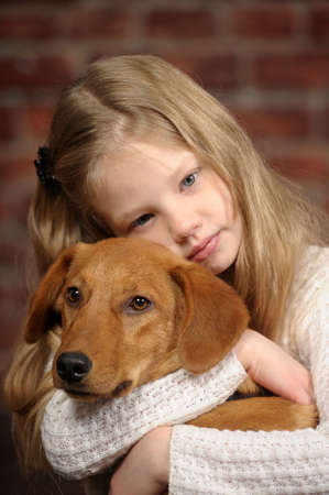 girl with red puppy hugs