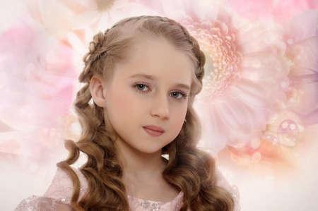 Beautiful fairy girl in a flowering garden