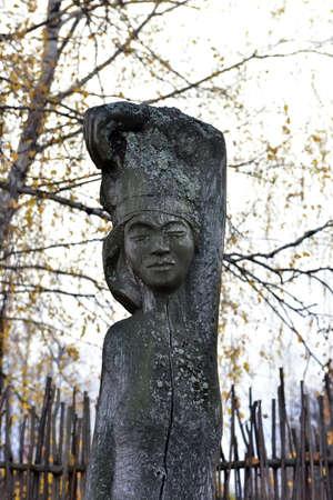 Photo pour wooden idols on autumn background - image libre de droit