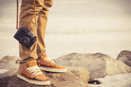 Foto de Feet man and vintage retro photo camera outdoor Travel Lifestyle vacations concept - Imagen libre de derechos