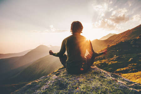 Photo pour Man meditating yoga at sunset mountains Travel Lifestyle relaxation emotional concept adventure summer vacations outdoor harmony with nature - image libre de droit