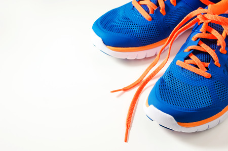 Photo pour Blue sport running shoes with orange shoelace - image libre de droit