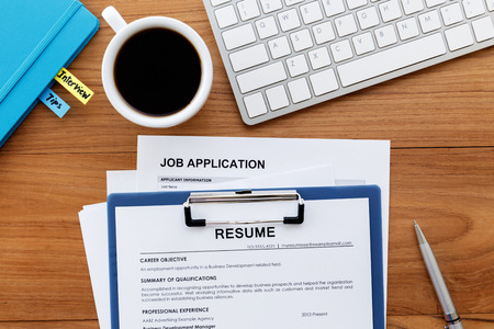Photo for Job search with resume and job application on computer work desk - Royalty Free Image
