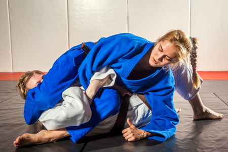 Foto de Two women are fighting on tatami. Judo, Jiu Jitsu. - Imagen libre de derechos