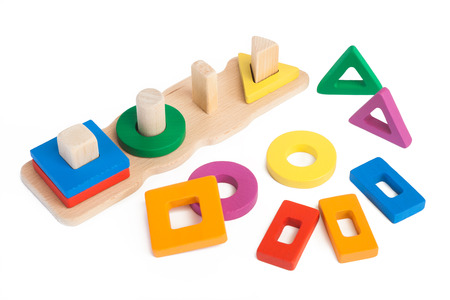 Photo pour Photo of a wooden toy children's sorter with small wooden details in the form of geometric shapes in different colors on a white isolated background - image libre de droit