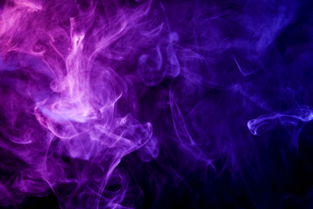 Photo pour Thick colorful blue and pink  smoke on a black isolated background. Background from the smoke of vape  - image libre de droit