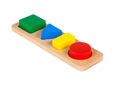 Photo pour Photo of a wooden toy  children's sorter with small wooden details in the form of geometric shapes (rectangle, square, circle, triangle), in different colors  on a white isolated background - image libre de droit