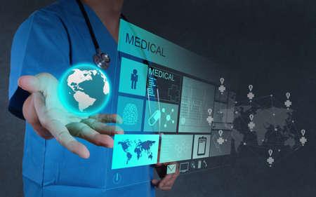 Photo pour Medicine doctor hand  working with modern computer interface as concept - image libre de droit