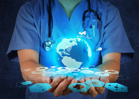 Photo for Medical Doctor holding a world globe in her hands as medical network concept - Royalty Free Image