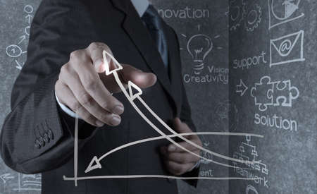 Foto de businessman hand draws business success chart concept on virtual screen - Imagen libre de derechos
