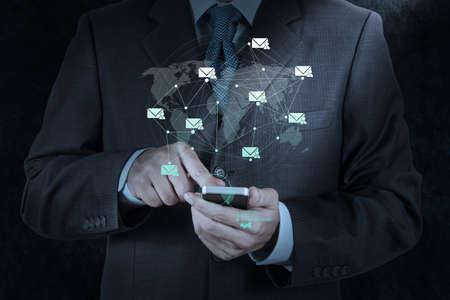 Foto de businessman hand use smart phone computer with email icon as concept - Imagen libre de derechos