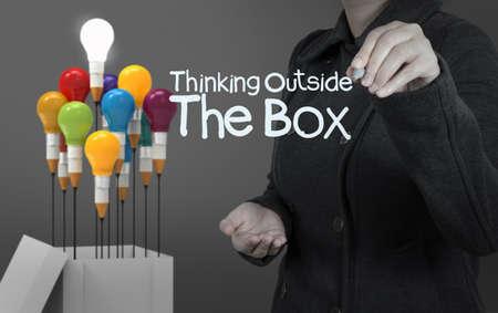 Foto de businesswoman hand draws word thinking outside the box as concept - Imagen libre de derechos