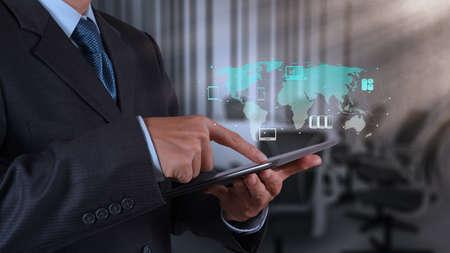 Foto de businessman hand using tablet computer and board room background - Imagen libre de derechos