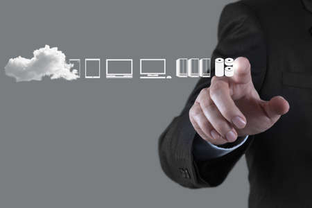 Foto de Businessman hand working with a Cloud Computing diagram on the new computer interface as concept - Imagen libre de derechos