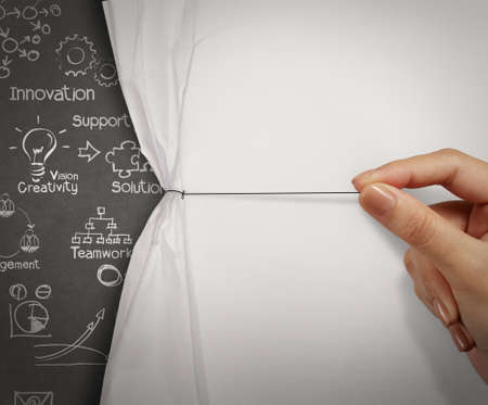 Foto de business hand pull rope open wrinkled paper show business strategy as concept - Imagen libre de derechos