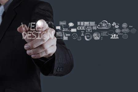 Foto de businessman hand  working with  web design diagram as concept  - Imagen libre de derechos